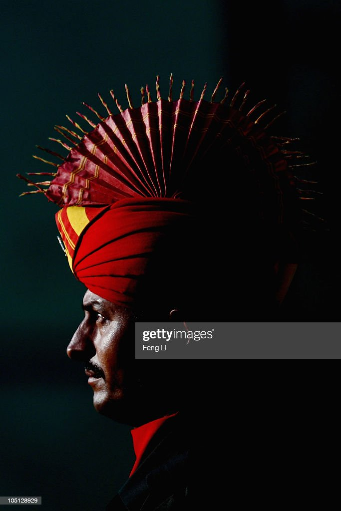 An India soldier stands during the medal ceremony following the Men's Singles Trap final at the Dr Karni Singh Shooting Range during day seven of the Delhi 2010 Commonwealth Games on October 10, 2010 in Delhi, India.
