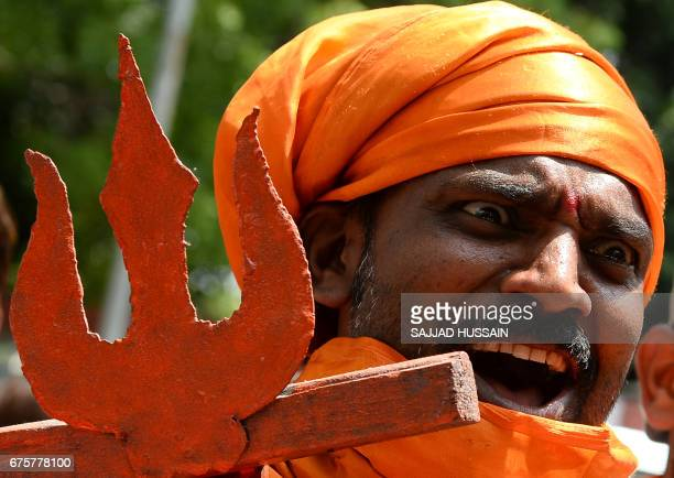 An Indian activist from the rightwing Bajrang Dal organisation shouts antiPakistani slogans during a protest in New Delhi on May 2 held to condemn...