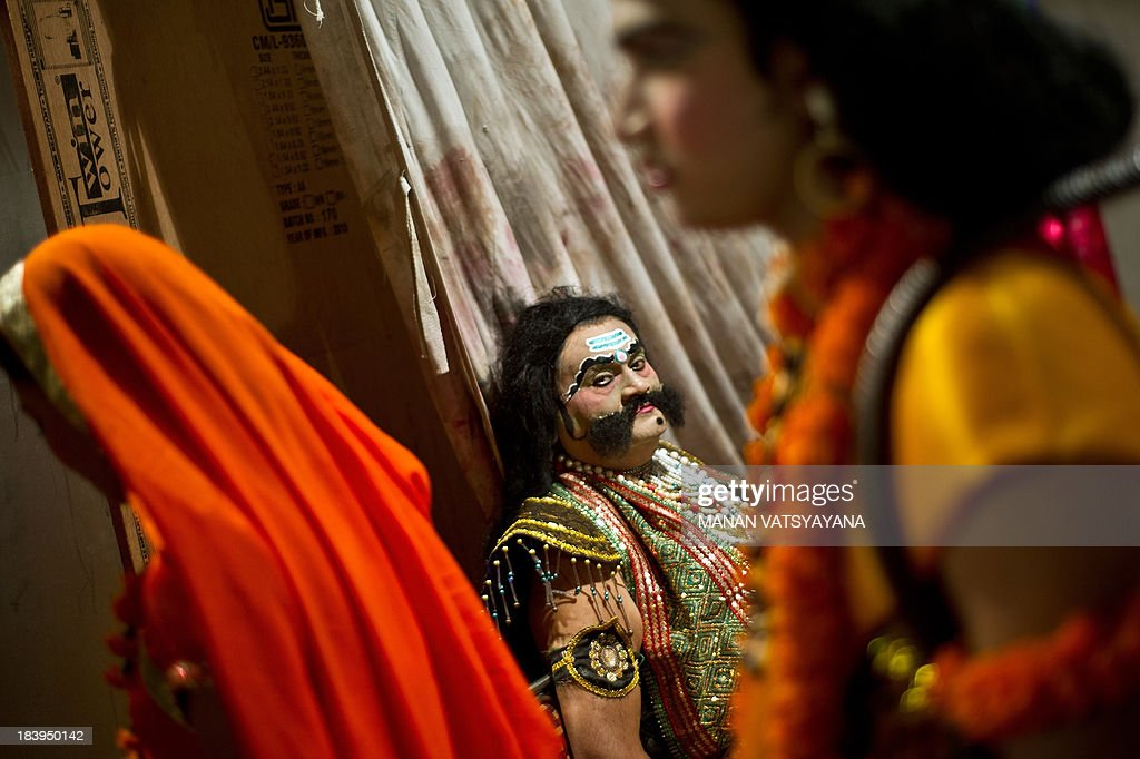 An Indian actor dressed as Demonking Ravana prepares backstage for a Ramlila performance a dramatisation of Hindu God Rama's life in New Delhi on...
