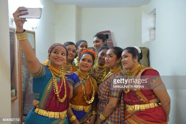 An Indian actors take a 'selfie' on a mobile phone in the green room ahead of a stage performance in Bangalore on March 27 during World Theatre Day /...