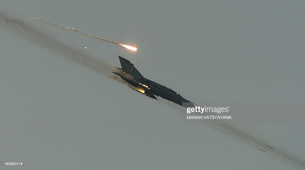 An Indian Air Force (IAF) Jaguar aircraft fires at the targets during the Iron Fist 2013 exercise in Pokhran on February 22, 2013. IAF held the Iron Fist 2013 exrecise to showcase its operational capabilities during day,dusk and night taking out simulated targets with precison laser-guided weaponry.