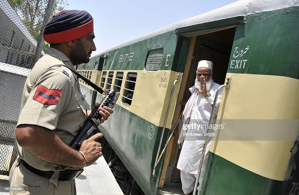 An Indian armed policeman keeping vigil on Pakistan-India bound Samjhauta Express train which leading towards the Attari Railway Station at India-Pakistan Attari border on April 29, 2013 near Amritsar, India. Security has been enhanced at border in of wake deadly attack on Indian prisoner Sarabjit Singh in Pakistan Jail.