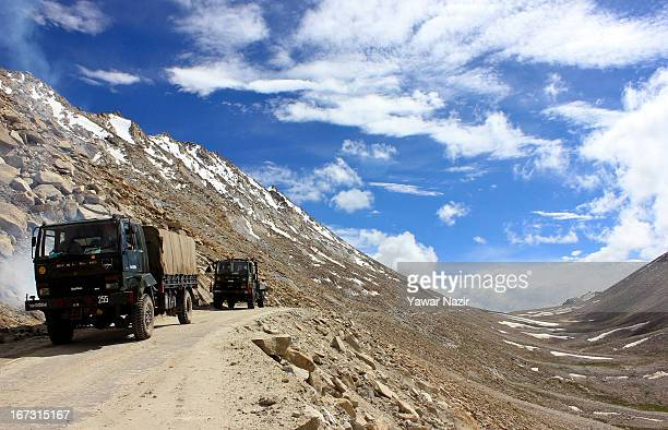 An Indian army convoy moves towards the border in Pangong a disputed territory between India and China on August 5 2012 in Ladakh Indianadministered...