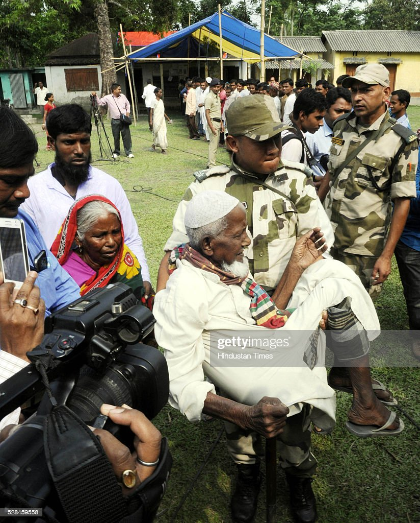 Indian army jawan carrying Asgar Ali 103 years old enclave dweller to the polling station to cast his vote for the first time at Maddhya Mashaldanga, Chhitmahal on May 5, 2016 in Coochbehar, India. More than 9,800 of the 10,100 eligible voters in former Bangladeshi enclaves of West Bengals Cooch Behar have enrolled for the voter list, signalling exceptional enthusiasm among the people who became Indian citizens less than nine months ago. These people have lived in a virtual no-mans land for 68 years because of a complex territorial division, which created enclaves or islands of foreign territory inside each country along the Indo-Bangladesh border. The two countries agreed in 2015 to swap the almost 200 enclaves located in one country but officially belonging to the other.
