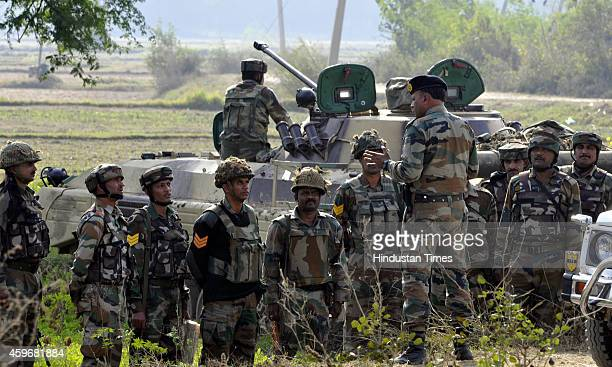 An Indian Army officer briefing his team during an encounter with militants at Pindi Khattar village of the Arnia border sector on November 28 2014...