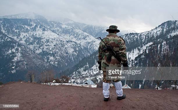 An Indian army officer looks towards Pakistan Administered Kashmir Churunda village on January 12 northwest of Srinagar the summer capital of Indian...
