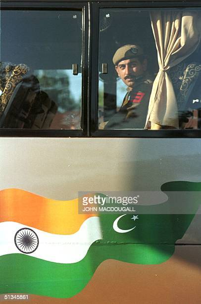 An Indian army officer peers out of the Delhi to Lahore bus decorated with Indian and Pakistani flags during a test run through the IndoPakistani...