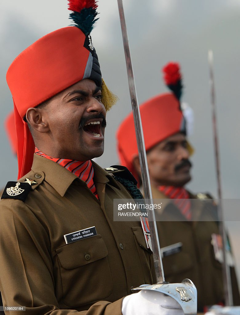 An Indian Army officer shouts orders during the Army Day parade in New Delhi on January 15, 2013. The 65th anniversary of the formation of the Indian national army was celebrated with soldiers from various regiments and artillery units taking part in a parade. AFP PHOTO/ RAVEENDRAN