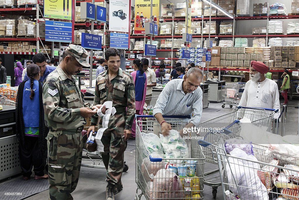 An Indian Army soldier checks his receipt near the checkout counter inside a Walmart India Pvt. Best Price Modern Wholesale store in the town of Zirakpur on the outskirts of Chandigarh, Punjab, India, on Tuesday, June 10, 2014. India's consumer price index (CPI) figures and wholesale price inflation figures for May are scheduled for release on June 12 and 16 respectively. Photographer: Udit Kulshrestha/Bloomberg via Getty Images