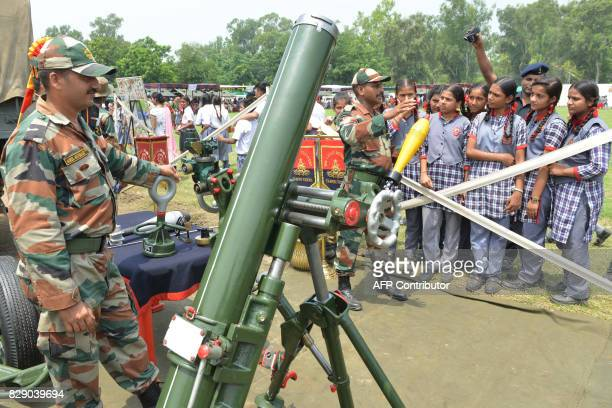 An Indian Army soldier explains the use of the 120 MM Brandt Mortar AM 50 to students during an Indian Army exhibition at Panther Stadium in Amritsar...