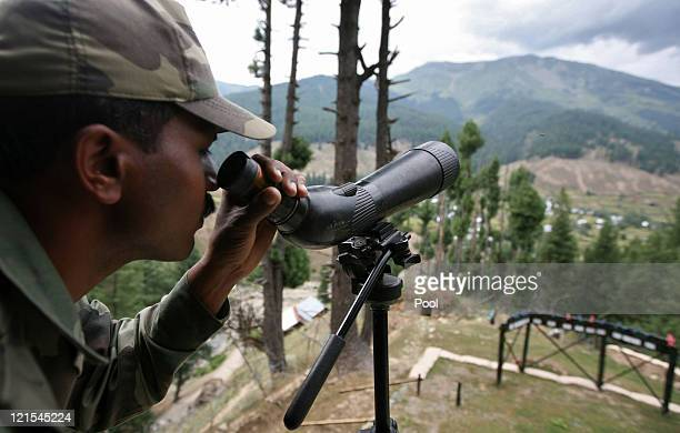 An Indian Army soldier guards the line of control the line dividing Kashmir between India and Pakistan after the Indian Army killed 12 suspected...