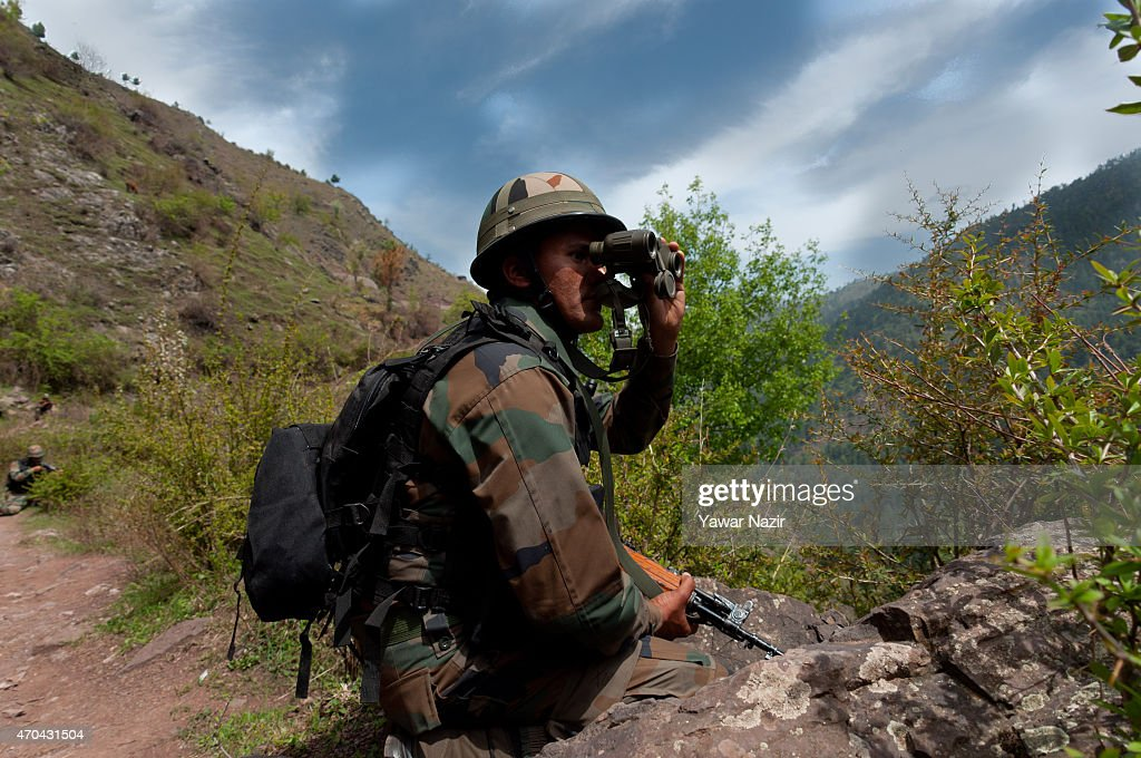 An Indian army soldier guards the the Line Of Control on April 20 2015 in Gohalan 120 Kms north west of Srinagar the summer capital of Indian...