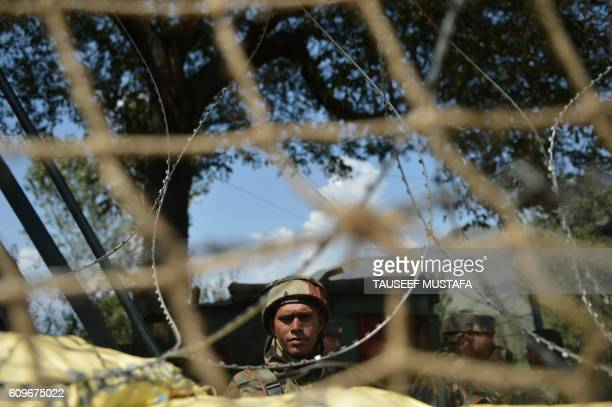 TOPSHOT An Indian army soldier looks on after clashes with suspected militants in the village of Bandipora north of Srinagar on September 22 2016 One...