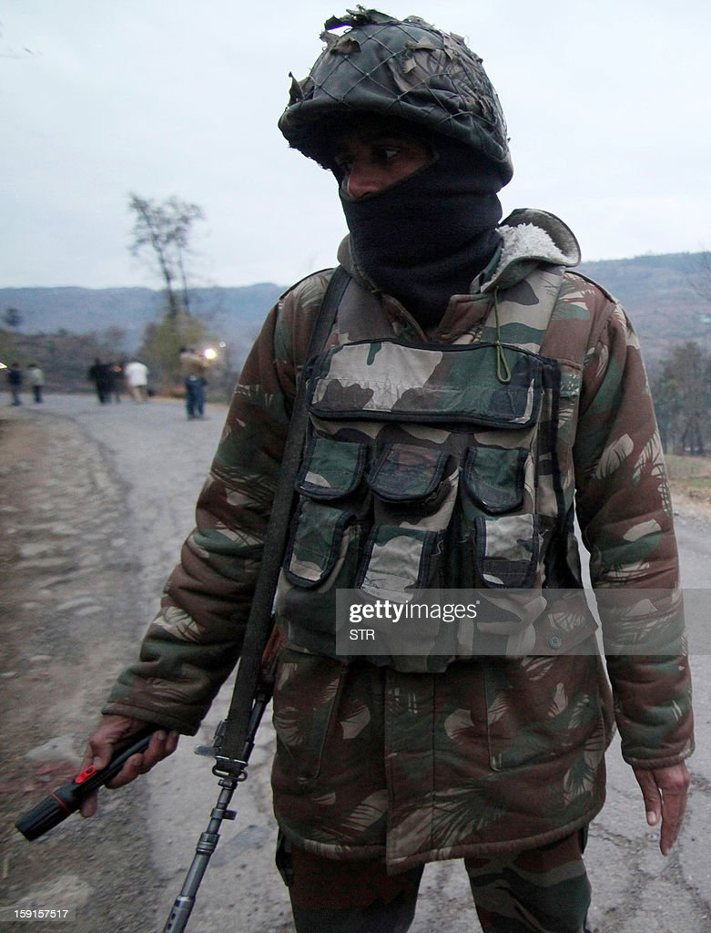 An Indian Army soldier patrols in Mendhar village near the Line of Control in the Poonch district of the Indian-administered state of Jammu and Kashmir on January 9, 2013. India summoned Pakistan's envoy in New Delhi Wednesday to protest the killing of two soldiers in a border clash, but warned against any escalation, after apparent tit-for-tat skirmishes that have led to deaths on both sides.