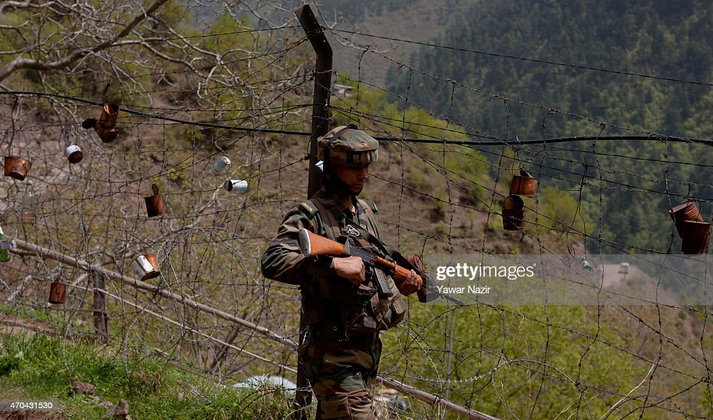 An Indian army soldier patrols the fenced area of Line Of Control on April 20 2015 in Gohalan 120 Kms north west of Srinagar the summer capital of...