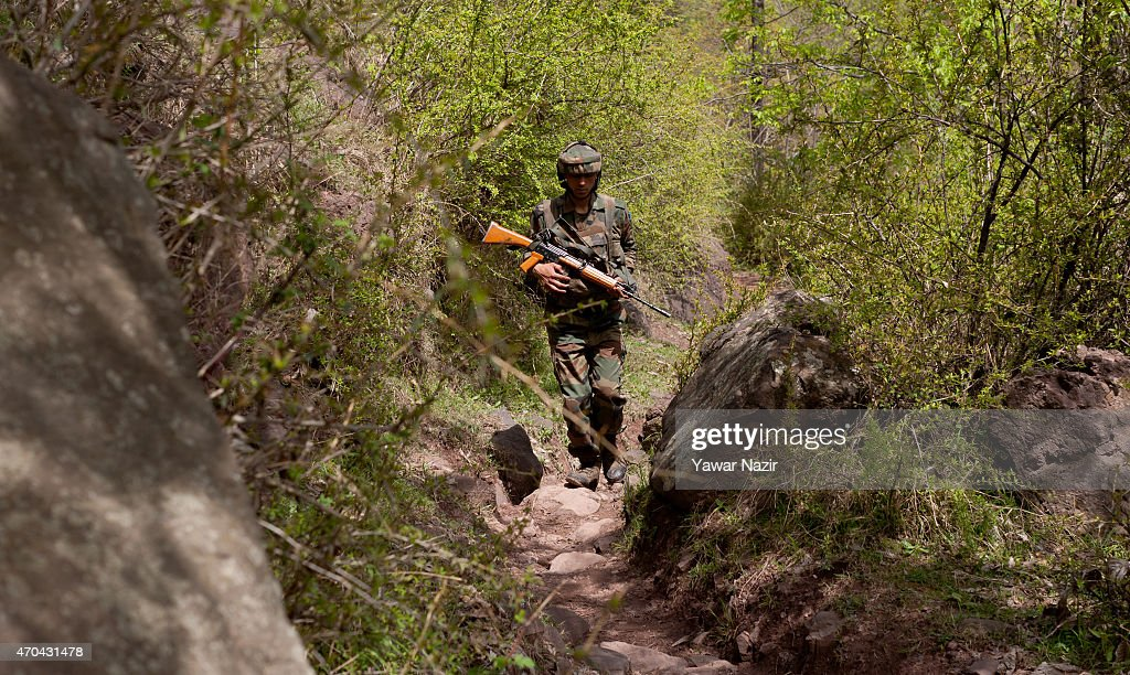 An Indian army soldier patrols the the Line Of Control on April 20 2015 in Gohalan 120 Kms north west of Srinagar the summer capital of Indian...