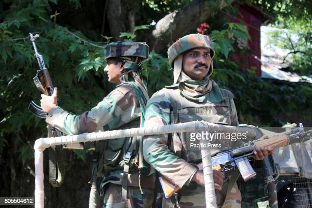 DAILGAM ANANTNAG JANMMU KASHMIR INDIA An Indian army soldier stands alert near the encounter site at Dailgam area of South Kashmir's Anantnag Indian...