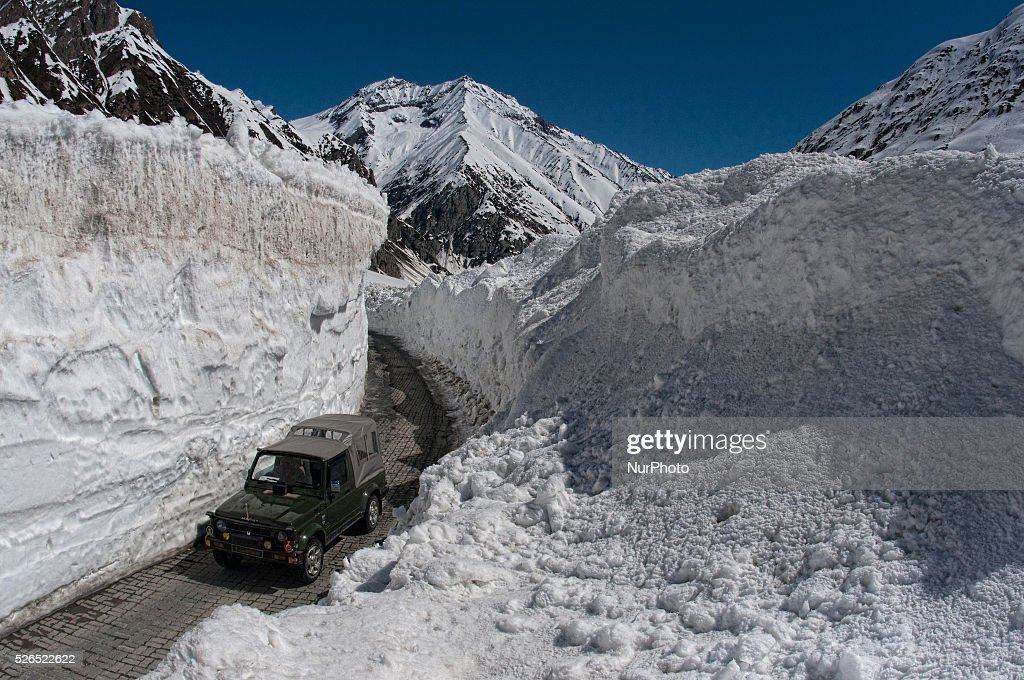 An Indian army vehicle passes through the snow cleared Srinagar-Leh highway in Zojila, 108 km (67 miles) east of Srinagar, the summer capital of Indian controlled Kashmir, India. on April 30, 2016. The 443 km (275 mile) long highway was opened for the season by Indian Army authorities after the remaining snow at Zojila Pass, some 3,530 metres (11,581 feet) above sea level, had been cleared. The pass connects Kashmir with the Buddhist-dominated Ladakh region, a famous tourist destination known for its monasteries, landscapes and mountains.