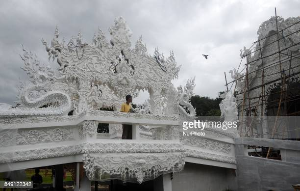 An Indian artisan prepares the temple of Thailand in a Puja pandal of goddess Durga ahead of Durga Puja festival in Kolkata India on Monday 18th...