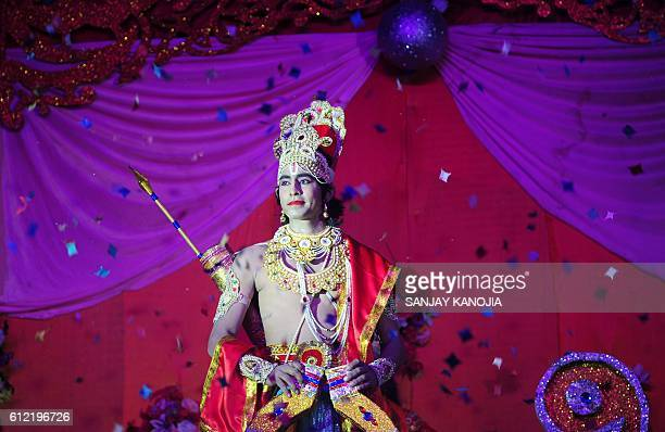 TOPSHOT An Indian artist dressed as Hindu God Rama performs during a production of the traditional drama 'Ramleela' narrating the life of Rama to...
