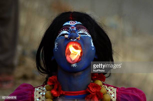 An Indian artist dressed as the Hindu Goddess Shakti participates in a procession to celebrate the Ram Navami festival in Allahabad on April 15 2016...