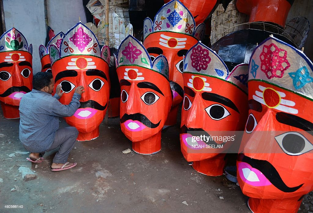 An Indian artist N.Shankar makes effigies of the Hindu demon king Ravana to celebrate the Dushhera-Vijaya Dashami festival at a workshop in Hyderabad, on October 14, 2015. Held at the end of the nine-day Navratri festival, Dussehra symbolises the victory of good over evil in Hindu mythology. On the night of Dussehra, fire-crackers stuffed effigies of Ravana are set alight in open grounds across the country. / AFP / NOAH