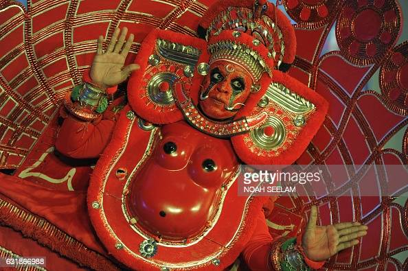 TOPSHOT An Indian artist performs a popular ritual dance 'Theyyam' also known as 'Kaliyattam' during an event organised by India's Kerala state...