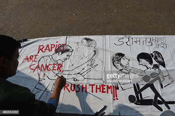 An Indian artist works on a banner condemning rape in New Delhi on December 16 the second second anniversary of the fatal gangrape of a student in...