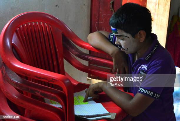 An Indian artistdressed as a character prepares for his dialogues brfore traditional Ramleelaa play narrating the life of Hindu God Ramon ocassion of...