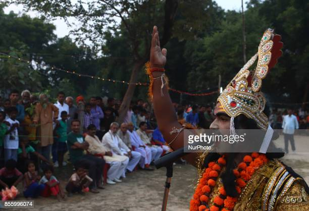 An indian artistdressed as Demon characterperforms during traditional Ramleelaa play narrating the life of Hindu God Ramon ocassion of Dussehra...