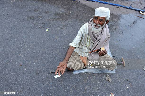 An Indian beggar reaches out for alms on the first day of the month of Ramadan in Hyderabad on July 212012 Like millions of Muslim around the world...