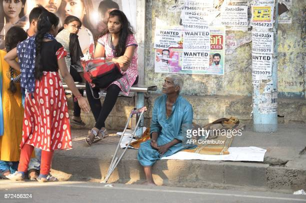 An Indian begger sits on the side of the road in Hyderabad on November 10 2017 A city in southern India has banned begging in public places ahead of...