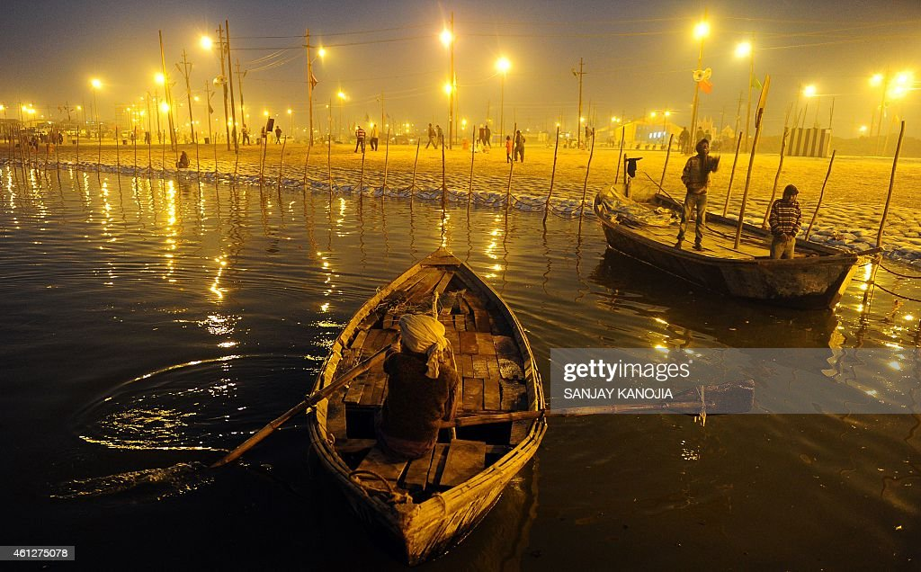 An Indian boatman rows to tie up his boat at Sangam during the annual Magh Mela in Allahabad on January 10 2015 The Magh Mela event lasts over a...