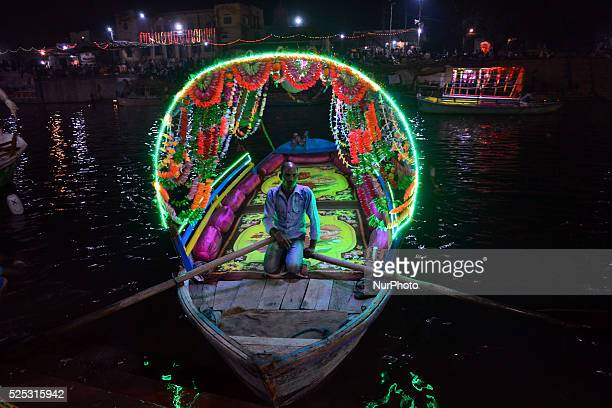 An indian boatman waits for customers in his boat at Ram Ghaton ocassion of Diwali festivalat Chitrakootabout 128 kms from Allahabad on November...