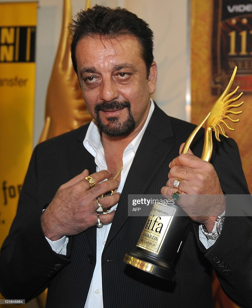 An Indian Bollywood actor Sanjay Dutt poses with a trophy after receiving best comedian actors award at the International Indian Film Academy (IIFA) awards in Colombo on June 5, 2010. Bollywood actors arrived in Sri Lanka to attend the three-day International Indian Film Academy (IIFA) awards and surrounding events that begun in Colombo on June 3. AFP PHOTO/ Punit PARANJPE