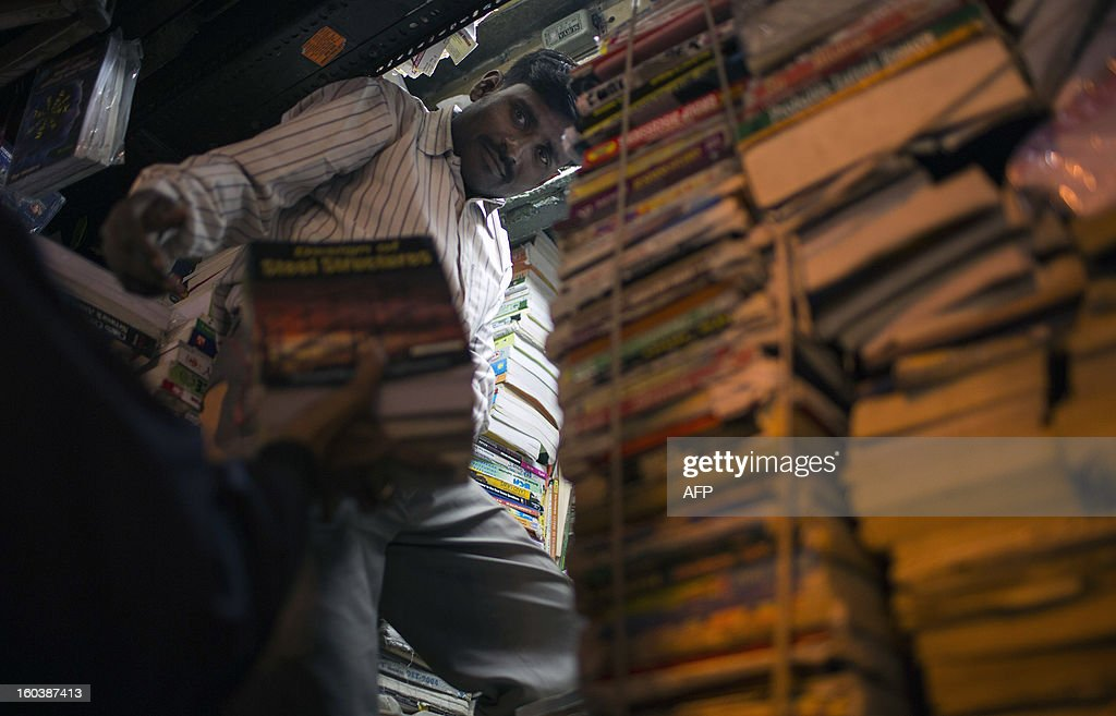 An Indian book vendor adds books to his small shop in the Old Quarters in New Delhi on January 30, 2013. Emerging economies are set to grow faster than the developed economies over the next four decades and India is likely to become one of the three largest economies by 2050, said a Pricewaterhouse Coopers report. AFP PHOTO/ Andrew Caballero-Reynolds
