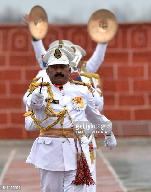 An Indian Border Security Force band performs during a passing out parade at BSF headquarter in Srinagar on March 8 2017 Some 126 new recruits were...