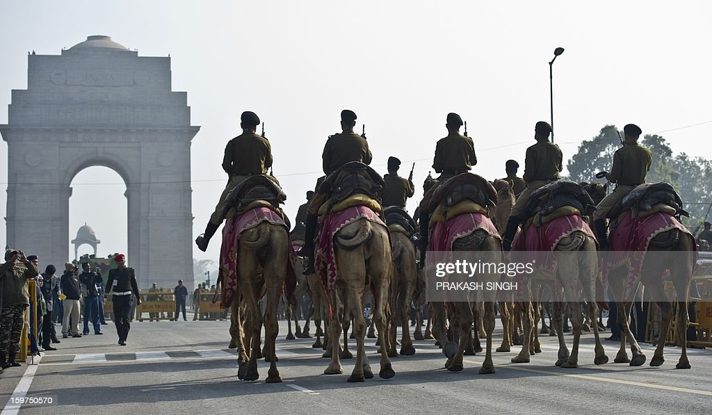 An Indian Border Security Force (BSF) camel contingent marches past Rajpath during a rehearsal for the Indian Republic Day parade in New Delhi on January 20, 2013. India will celebrate its 64th Republic Day on January 26 with a large military parade. AFP PHOTO / Prakash SINGH