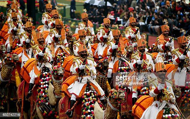 An Indian Border Security Force contingent march during the 68th Republic Day parade in New Delhi on January 26 2017 Motorbike stunt riders and herds...