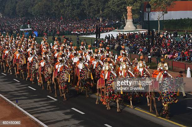 An Indian Border Security Force contingent on camels marches during the full dress rehearsal for the upcoming Indian Republic Day parade in New Delhi...