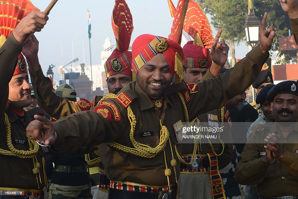 An Indian Border Security Force (BSF) soldier dances as he celebrates the country's 64th Republic Day at the India-Pakistan border post in Wagah on January 26, 2013. India celebrated its 64th Republic Day with a military parade in several towns across the country.