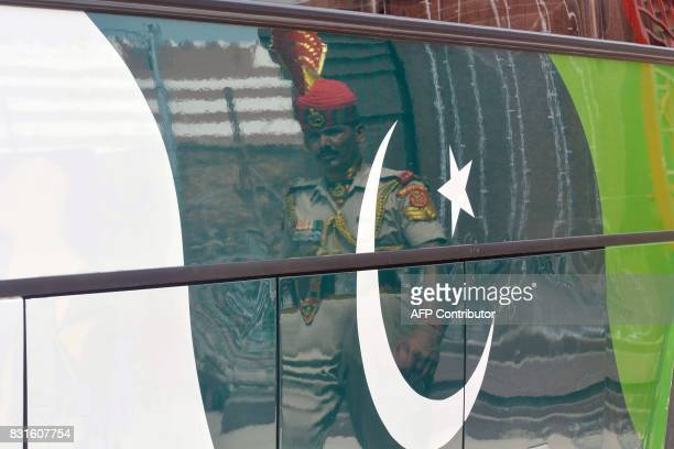 An Indian Border Security Force soldier escorts the Pakistani DelhiLahore bus as India's marks its Independence Day at the IndiaPakistan Wagah border...