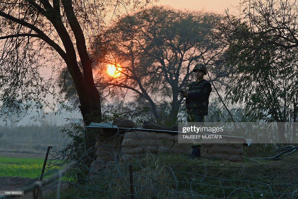 An Indian Border Security Force (BSF) soldier keeps watch at an outpost along the India-Pakistan border in Abdulian, 38 kms southwest of Jammu, on January 9, 2013. India delivered a dressing-down to Islamabad's envoy to Delhi as it accused Pakistan's army of beheading one of two soldiers killed in Kashmir, but both sides warned against inflaming tensions. AFP PHOTO/Tauseef MUSTAFA