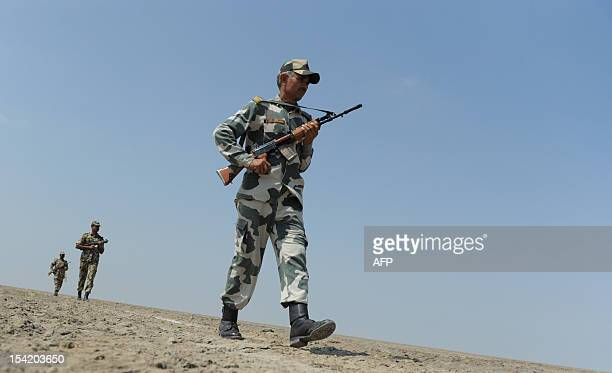 An Indian Border Security Force soldier marches during a patrol at Border Pillar No 1175 the last international border pillar along the horizontal...