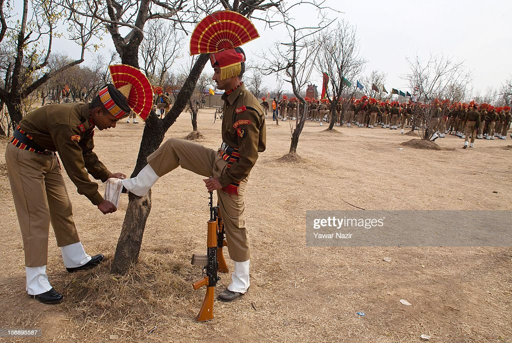 An Indian Border Security Force (BSF) soldier polishes a comrades boots before their passing out parade on November 24, 2012 in Humhama, on the outskirts of Srinagar, the summer capital of Indian administered Kashmir, India. 545 new trained recruits of the Indian paramilitary Border Security Force constables took oaths during their passing out parade after successfully completing 36 weeks of basic training which involved physical fitness, weapons handling, map reading, counter-insurgency operations and human rights. The recruits will join Indian soldiers to fight militants in Kashmir, a spokesman of the paramilitary BSF said. India has already close to a million soldiers posted in Jammu and Kashmir, making the disputed Himalayan region one of the most militarized zone in the world