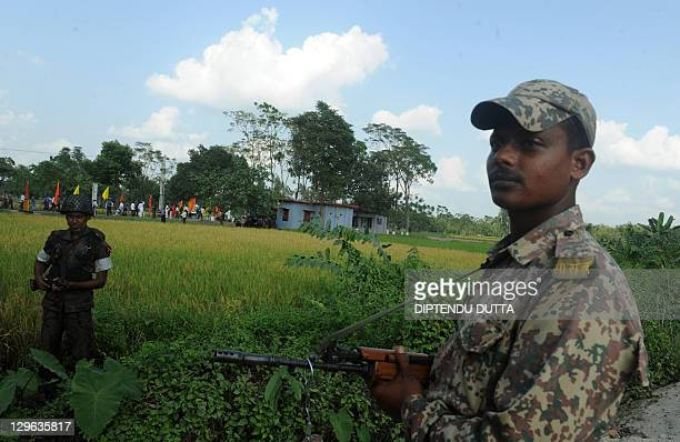 An Indian Border Security Force soldier stands guard as an Bangladesh Border Guard soldier looks on ahead of the visit of Bangladesh Prime Minister...