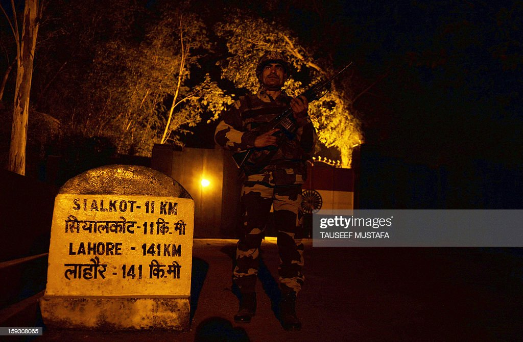 An Indian Border Security Force (BSF) soldier stands guard near a gate at an outpost along the India-Pakistan border in Suchit-Garh, 36 kms southwest of Jammu on January 11, 2013. Pakistan summoned the Indian ambassador to protest against 'unacceptable and unprovoked' attacks by the Indian army that killed two Pakistani soldiers in five days in Kashmir. AFP PHOTO/ Tauseef MUSTAFA