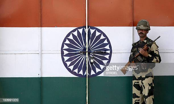 An Indian border security force soldier stands guard on the gate of Suchetgarh India/ Pakistan border about 25 Km from the northern city of Jammu on...
