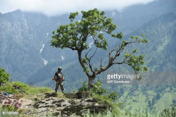 An Indian Border Security Force soldier stands guard on top of a hill in Chandanwari in Anantnag district some 115 km southeast of Srinagar during...