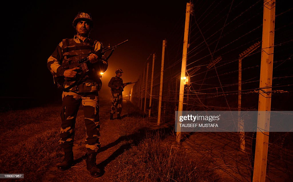 An Indian Border Security Force (BSF) soldiers patrol along the border fence at an outpost along the India-Pakistan border in Suchit-Garh, 36 kms southwest of Jammu on January 11, 2013. Pakistan summoned the Indian ambassador to protest against 'unacceptable and unprovoked' attacks by the Indian army that killed two Pakistani soldiers in five days in Kashmir. AFP PHOTO/ Tauseef MUSTAFA